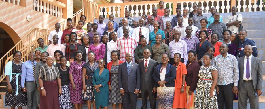 Dr. Umar Kakumba (7th Front-Right) - Deputy Vice Chancellor Academic Affairs pose for a group photo with participants after opening a two-day seminar (14th -15th March 2019) organised by the Department of  Academic Registrar.