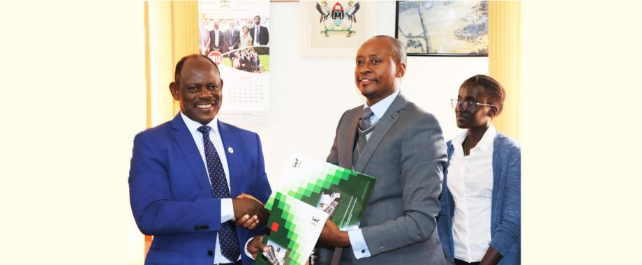 Mak Vice Chancellor Prof. Barnabas Nawangwe (Left) exchange the MoU with the Chairman, Board of Africa Strategic Leadership Centre, Dr. Robert Mwesigwa Rukaari