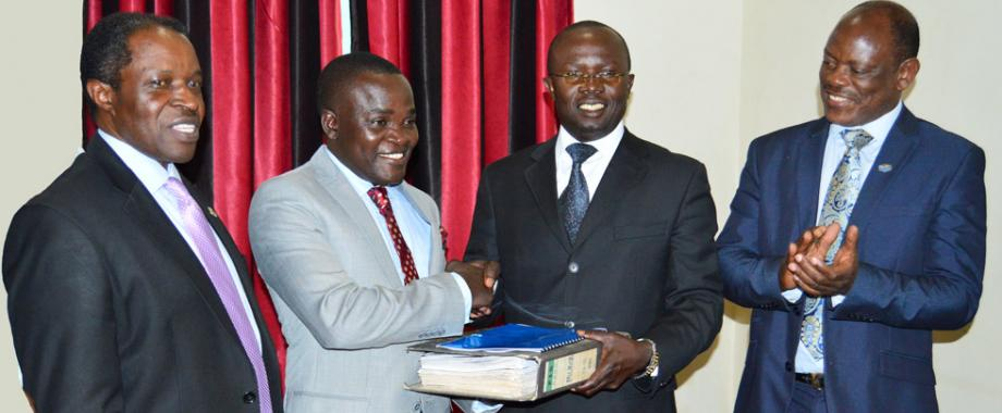 The Commissioner of Oaths His Worship Mr Lawrence Tweyanze has witnessed the swearing in of the executive of Makerere University Academic Staff Association(MUASA) 2018-2020. At the ceremony the outgoing Chairperson Dr Muhammad Kiggundu(2nd R) handed over to Dr. Deus Kamunyu Muhwezi(2nd L). The Vice Chancellor Prof. Barnabas Nawangwe(R)  and Deputy Vice Chancellor(F/A) Prof. William Bazeyo (L) were present including representatives from Ministry of Public Service and Ministry of Education.