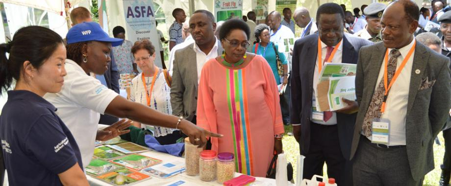 Hon. Mary Karoro Okurut - Minister in Charge of General Duties in the Office of the Prime Minister (3rd Right) after the opening ceremony of the 4-day conference. On her left is the Minister of State for Agriculture, Animal Industry and Fisheries, Hon Christopher Kibazanga at an exhibition on 12th November, 2018 at Speke Resort Munyonyo, Kampala.