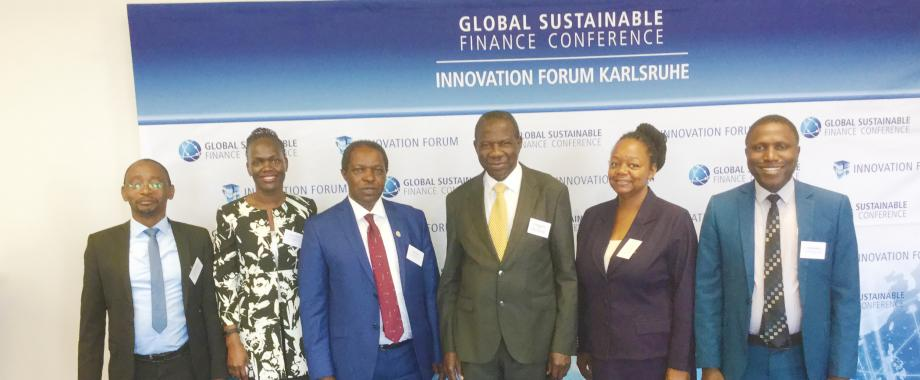 [L-R] Dr. Roy William Mayega, RAN Deputy Chief of Party; Mrs. Patricia Ojangole, Chief Executive Officer of Uganda Development Bank; Prof. William Bazeyo, RAN Chief of Party; Hon. Matia Kasaija,  Uganda's current Minister for Finance; Dr. Dorothy Okello, RAN Director Innovation and Nathan Tumuhamye, RAN Eastern Africa Resilience Innovation Lab Director at a Sustainable Finance Conference in Germany held July 12-13, 2018.