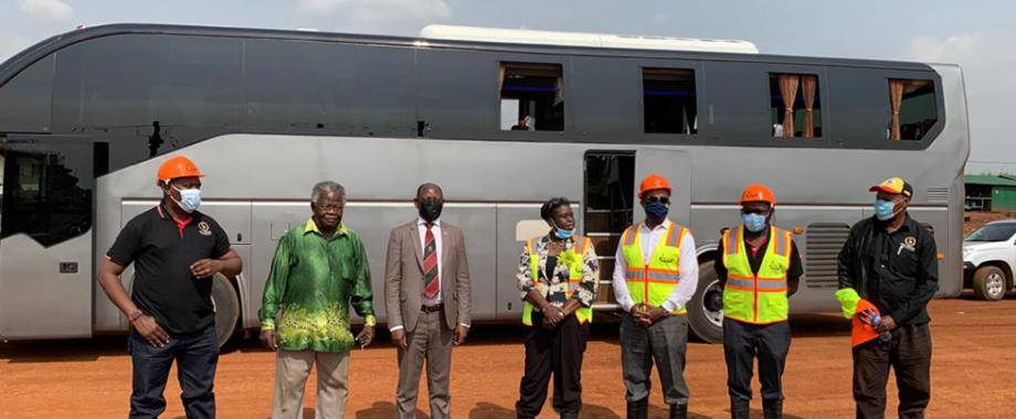 Dr. Paul Musasizi Kiira Motors Corporation(KMC) CEO (Left), Executive Chairman KMC- Prof. Sandy Stevens Tickodri-Togboa (Second Left),Vice Chancellor Prof. Barnabas Nawangwe (Third Left) join others in a group photo. Behind them is the Kayoola Diesel Bus.
