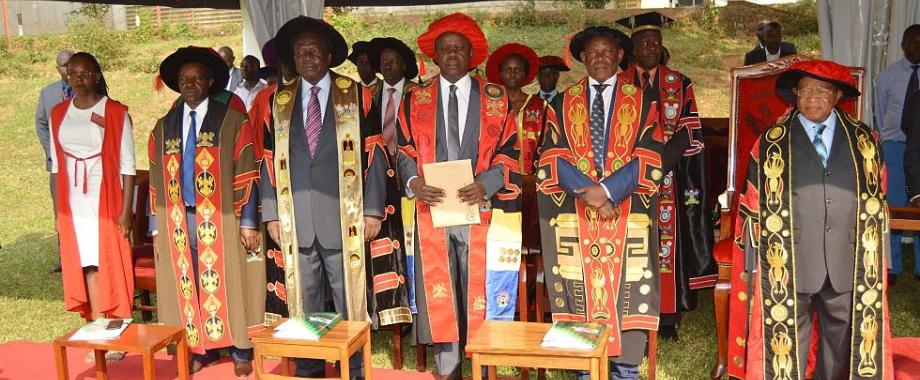 R-L: Chancellor-Prof. Ezra Suruma, Vice Chancellor-Prof. Barnabas Nawangwe, Principal MUBS-Prof. Wasswa Balunywa, Chair Council-Eng. Dr. Charles Wana-Etyem, DVCFA-Prof. William Bazeyo and the Mace Bearer from MUBS at the third session of the 68th Graduation Ceremony, 18th January 2018, Freedom Square, Makerere University, Kampala Uganda. MUBS Produced the Best Overall Student and Best Student-Female Scholarship Foundation