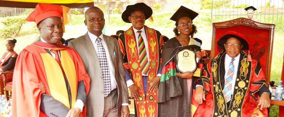 R-L: The Chancellor-Prof. Ezra Suruma, Best Overall Student-Ms. Namukose Rita, Vice Chancellor-Prof. Barnabas Nawangwe, Ms. Namukose's Father and Chairperson Convocation-Dr. Tanga Odoi at Day 3 of the 70th Graduation Ceremony, 16th January 2020, Makerere University, Kampala Uganda.