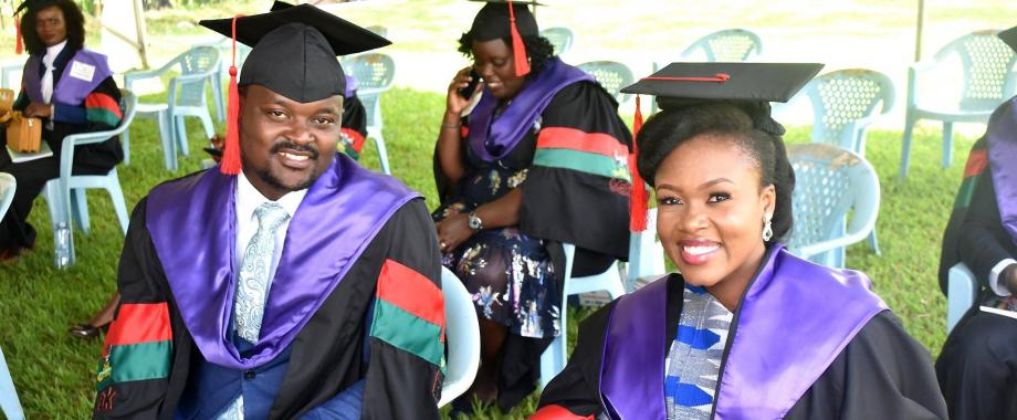 Soroti District Woman MP and Former Mak Guild President, Hon. Anna Ebaju Adeke (R) with fellow Master of Laws Graduands on Day 1 of the 71st Graduation Ceremony, 17th May 2021, Freedom Square, Makerere University.