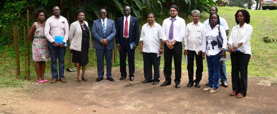 Mr. Robert Odok Oceng-Commissioner for Higher Education and Training (5th L), Vice Chancellor-Prof. John Ddumba-Ssentamu (4th L), Director PDD-Dr. Florence Nakayiwa (3rd L), Director EWD-Eng. Fred Nuwagaba (2nd L) with Excel Construction Officials and PDD Staff at the Site Handover Ceremony on 18th December 2015, School of Social Sciences, Makerere University, Kampala Uganda