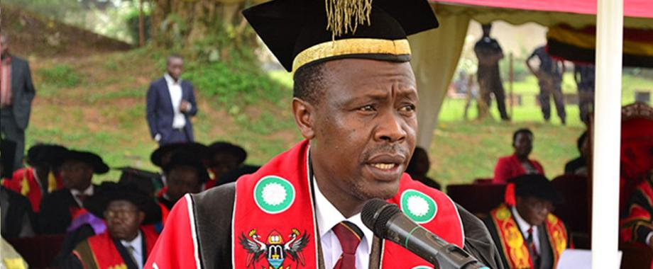 The Academic Registrar, Mr. Alfred Namoah Masikye addresses the congregation at a previous graduation ceremony in the Freedom Square, Makerere University.