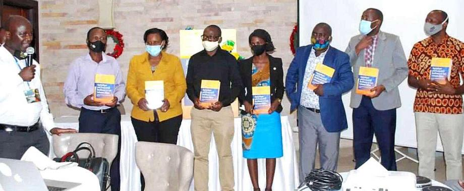 The book's Lead Editor-Assoc. Prof. Yazidhi Bamutaze (L), Dr. Justine Namaalwa (3rd L) and other officials at the launch on 4th December 2020, Kampala Uganda.