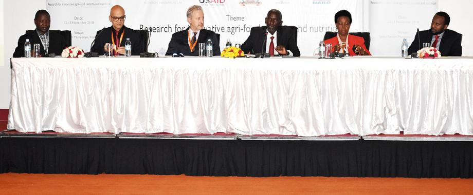 L-R:  Dr. Daniel Waiswa (Mak), Dr. Ahmed Kablan (USAID), Prof. Patrick Webb (Tufts University), Dr. Yona Baguma (NARO and Session Chair), H.E. Rhoda Tumusiime and Edgar (WFP) during the opening session on Day2 of the NARO-Mak Conference, 13th November 2018, Kampala Uganda