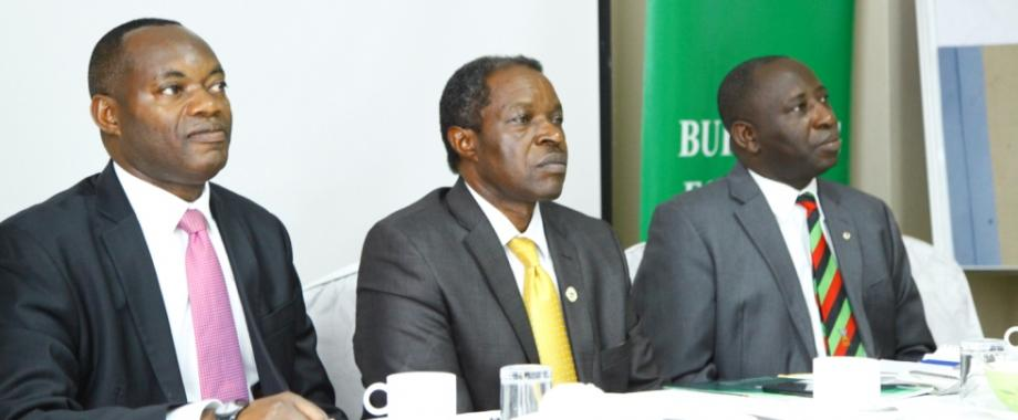 DVCFA-Prof. William Bazeyo (C) flanked by Chairperson Board of Trustees, SAIU-H.E. King Caesar Augustus Mulenga (L) and Principal CHS-Dr. Charles Ibingira (R) at the launch of the Non Communicable Diseases-NCD Media Training ahead of the Symposium in February 2018. NCDs  represent a rapidly growing disease burden (morbidity and mortality), accounting for 70% of all deaths world wide each year of 15 million people between the age of 30 and 69 years (WHO 2017).