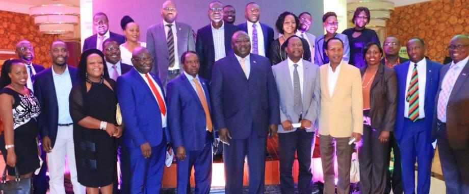 Chief Guest, State Minister for International Affairs-Hon. Henry Oryem Okello (C), DVCFA-Prof. William Bazeyo (5th L) with Members of Management, Staff and Guests at the Upcoming Non-Communicable Diseases Symposium 2018 Fundraising Dinner, 12th December 2017, Pearl of Africa Hotel, Kampala Uganda. NCDs represent a rapidly growing disease burden (morbidity and mortality), accounting for 70% of all deaths world wide each year of 15 million people between the age of 30 and 69 years (WHO 2017).