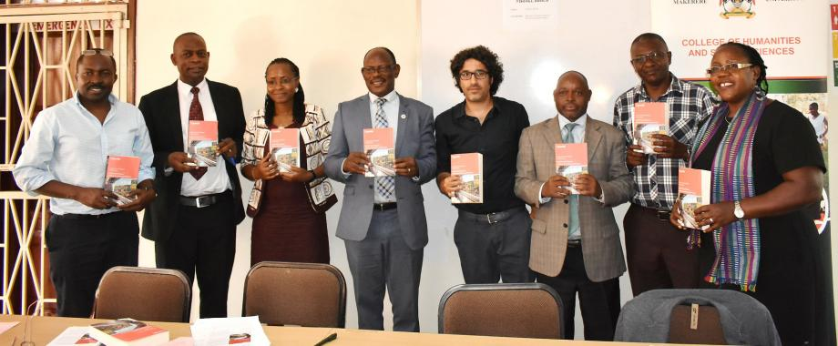 """The Vice Chancellor, Prof. Barnabas Nawangwe (4th L) is joined by Ag. Principal CHUSS-Dr. Josephine Ahikire (R), Director QAD-Dr. Vincent Ssembatya (2nd L), Dean SWGS-Dr. Sarah Ssali (3rd L), Dr. Giuliano Martiniello (4th R), Prof. Jean Barya (3rd R) and other officials to launch the """"Uganda: The Dynamics of Neoliberal Transformation"""" book on 15th April 2019, SWGS, CHUSS, Makerere University, Kampala Uganda"""