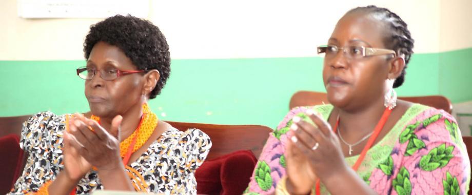 The Vice Chancellor Kabale University-Prof. Joy C. Kwesiga (Left) and Acting CHUSS Principal-Dr. Josephine Ahikire (Right) applaud during the opening session of the 2019 CHUSS Symposium on 15th May 2019, Main Hall, Makerere University, Kampala Uganda