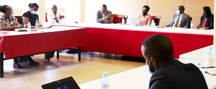 The Vice Chancellor-Prof. Barnabas Nawangwe (2nd R), Stanbic Bank CEO-Ms. Anne Juuko (R), Ag. DVCFA, Dr. Josephine Nabukenya (3rd R) and other members of Central Management listen to DVCAA-Dr. Umar Kakumba (4th L) during the meeting on 12th April 2021, CTF1, Makerere University.