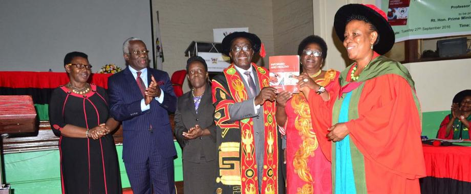 "R-L: The Author-Prof. Maria Musoke, Minister in Charge of General Duties in the Office of the Prime Minister-Hon. Mary Karooro Okurut, Makerere University Vice Chancellor-Prof. John Ddumba-Ssentamu, Lady Justice Prof. Lillian Tibatemwa-Ekirikubinza, Buganda Government Spokesperson and Minister for Lukiiko, Cabinet and Administration-Owek. Denis Walusimbi Ssengendo and Hon. Dr. Miria Matembe Launching ""Informed and Healthy"""
