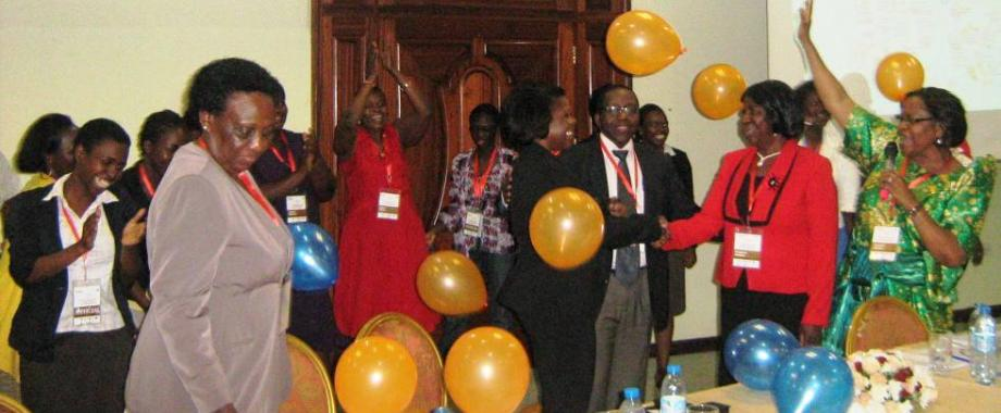 Dr. Raymonda Burgman, Director HERS Institutes USA, shakes hands with Chair HERS-EA Dr. Margaret L. Khaitsa (2nd R) as participants in HERS-EA cheer after the official inauguration, 5th August 2014, Imperial Royale Hotel, Kampala Uganda