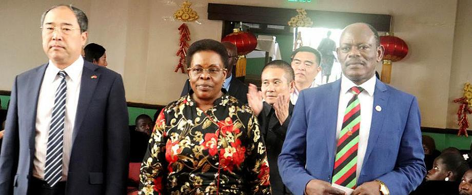 L-R: Chinese Ambassador to Uganda-H.E. Zheng ZhuQiang, Minister for KCCA-Hon. Beti Olive Kamya and the Vice Chancellor-Prof. Barnabas Nawangwe make their way into the Main Hall for the Confucius Institute 4th Anniversary Celebrations as Outgoing Director-Prof. Hong Yonghong (Rear) applauds, 9th November 2018, Makerere University, Kampala Uganda