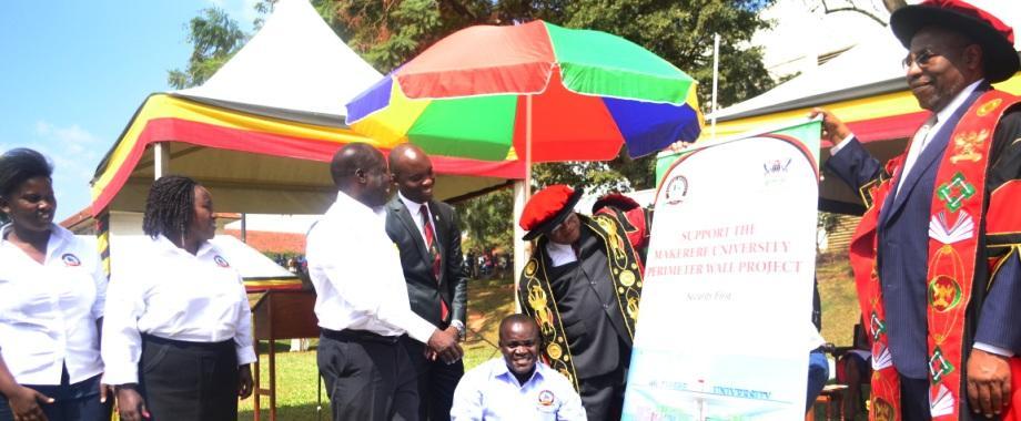 R-L: The Prime Minister-Rt. Hon. Dr. Ruhakana Rugunda, Chancellor-Prof. Ezra Suruma, Dr. Deus K. Muhwezi (squatting), Guild President-H.E. Roy Ssemboga, Chairperson Convocation-Dr. Tanga Odoi, Vice Chairperson-Nyago Diana at the Perimeter Wall Fundraising Drive, 21st February 2017, Freedom Square, Makerere University, Kampala, Uganda