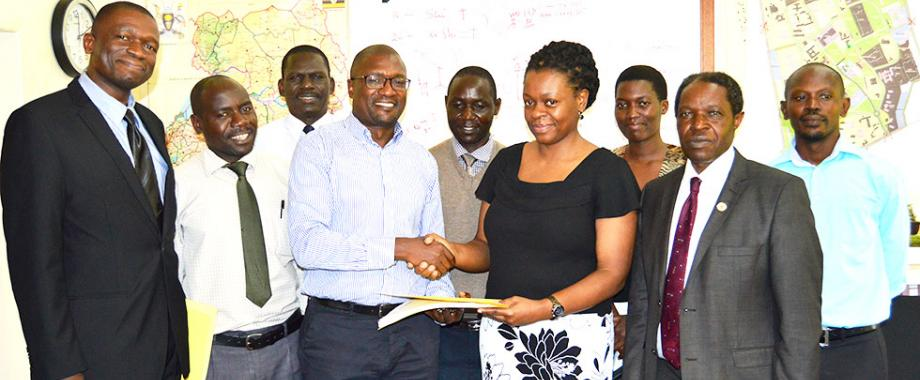 L-R: Mr. Augustine Tamale, Mr. Ssanyu Lawrence, EWD Staff Member, Eng. Fred Nuwagaba, Mr. Patrick Akonyet, Eng. Christina Kakeeto, Ms. Catherine Awor, DVCFA-Prof. William Bazeyo and Mr. Darius Muwanguzi during the handover ceremony, 30th November 2017, EWD Offices, Makerere University, Kampala Uganda. Prof. Bazeyo urged the EWD Staff to accord the incoming Director Eng. Christina Kakeeto all the necessary support.