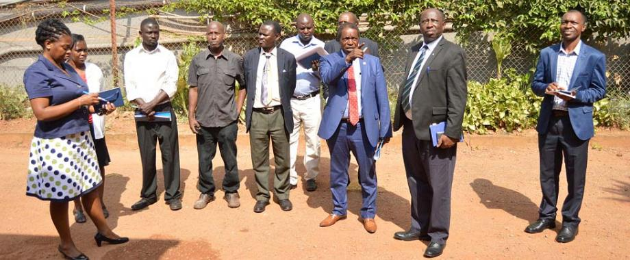 DVCFA-Prof. William Bazeyo (3rd R) makes his observations to the contractor (4th L) as R-L: Mr. Gordon Murangira, Dr. Charles Ibingira, Eng. Justus Akankwasa (rear), Mr. Paul Funa, Mr. Grace Kityo, Eng. Joseph Jurua, Dr. Margaret Wandera and Eng. Christina Kakeeto take note. This was during the inspection of Phase I of renovations at the Makerere University Hospital, 23rd January 2018.