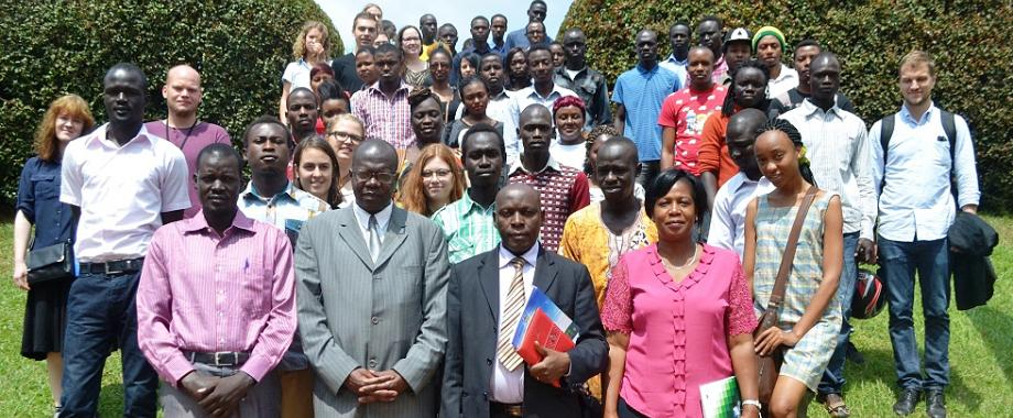 Front Row: The DVCAA-Dr. Ernest Okello Ogwang (2nd L), Mr. Charles Ssentongo-Deputy Registrar Undergraduate Admissions and Records, Ms. Martha Muwanguzi-Head International Office with International Students after the meeting on 28th August 2014, Makerere University, Kampala Uganda