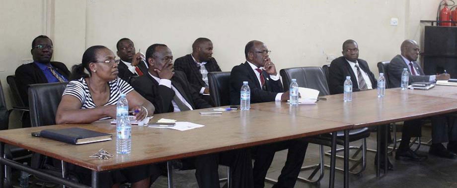 Vice Chancellor-Prof. Barnabas Nawangwe (3rd R) flanked by L-R: Mr. Walter Bruno Yorac Nono, Dr. Hellen Byamugisha, Mr. Cyriaco Kabagambe, Mr. Alfred Masikye Namoah, Mr. Frank Kitumba, Mr. Augustine Tamale and Mr. Goddy Muhumuza during Top Management's interface with the School of Law on 14th February 2018. Management announced that Academic staff at the School of Law can now get their Practicing Certificates through the Directorate of Legal Affairs Makerere University.