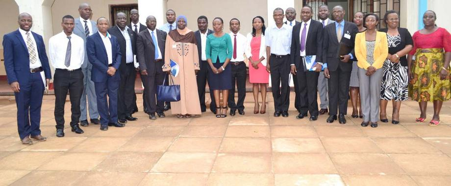 Chairperson and Secretary MURBS Board of Trustees-Hajati Fatumah Nakatudde and Dr. John Kitayimbwa (Centre) flanked by MURBS Staff, Trustees, and representatives of the Scheme Administrator, Fund Managers, Custodian, Bankers and Auditors after the 6th AGM, 27th October 2016, Main Hall, Makerere University, Kampala Uganda