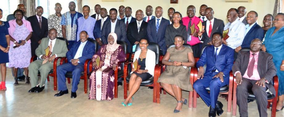Sitted: DVCFA-Prof. Barnabas Nawangwe (2nd L), Fmr. MURBS Chairperson-Hajati Fatumah Nakatudde (3rd L), Ms. Miriam Magala-ULS, Ms. Daisy Linda Nabakooza-URBRA, Mr. Daniel Badebye-URBRA with outgoing and incoming MURBS Trustees after the handover ceremony, 3rd April 2017, Senate Conference Hall, Makerere University, Kampala Uganda