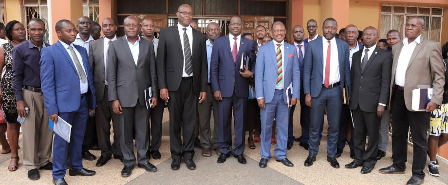The Vice Chair of Council, Rt. Hon. Daniel Fred Kidega (5th Right) and Vice Chancellor, Prof. Barnabas Nawangwe (4th Right) with Front Row (Left to Right): Dr. Michael Walimbwa (MUASA), Mr. Martin Nsubuga (CEO URBRA), Mr. Wilber Grace Naigambi (Chair BoT MURBS), Mr. Yusuf Kiranda (Ag. US), Dr. Muhammad Kiggundu Musoke and Mr. Chris Kananura (IRA) at the MURBS FY 2018/19 Performance Presentation 11th October 2019, Makerere University, Kampala Uganda