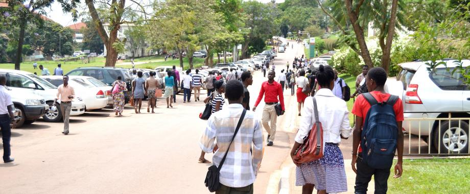 Students walk past the School of Agricultural Sciences along University Road, Makerere University, Kampala Uganda. Date taken: 6th October 2014. Diploma Holders are eligible for admission to Mak Degree Programmes under the Government Sponsorship Scheme (not exceeding 5% of the intake capacity).