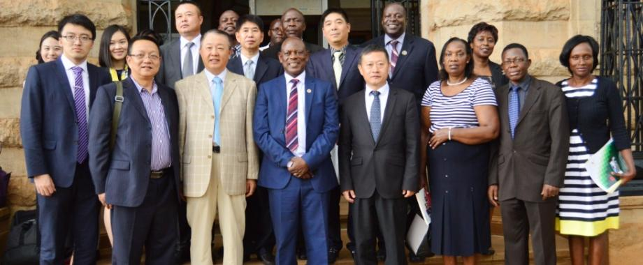 The UNESCO-ICHEI delegation led by Prof. Li Ming (3rd L) with Vice Chancellor-Prof. Barnabas Nawangwe (4th L) and members of Management after signing the tripartite MoU between UNESCO-ICHEI, Makerere University and Southern University of Science and Technology (SUSTech), China to collaborate in the areas of ICT and E-Learning on 17th November 2017, Makerere University, Kampala Uganda