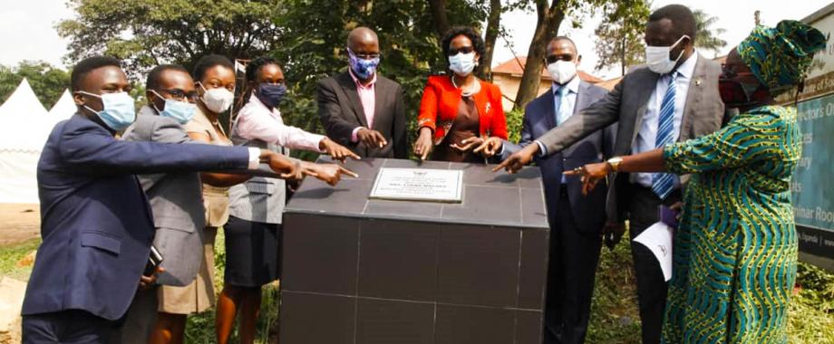 Chairperson of University Council Mrs. Lorna Magara flanked by the Ag. Vice Chancellor Dr. Umar Kakumba (on her Right) and Principal of School of Law Prof. Christopher Mbazira (on her Left) and other stakeholders at the ground breaking ceremony held on 6th July 2021 at the School of Law.