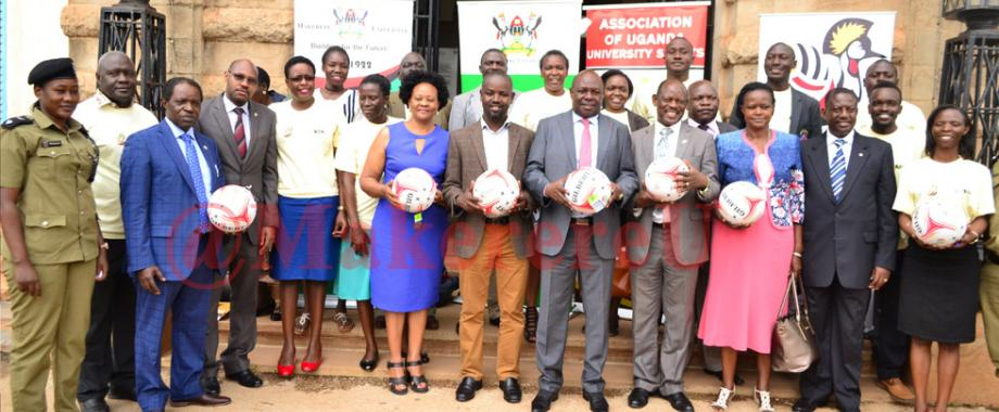 Minister of State for Sports, Hon. Charles Bakkabulindi (5th Left Front Row) poses for a photo together with some of the members of the Local Organising Committee for the World University Netball Championship 2018 on 1st August 2017